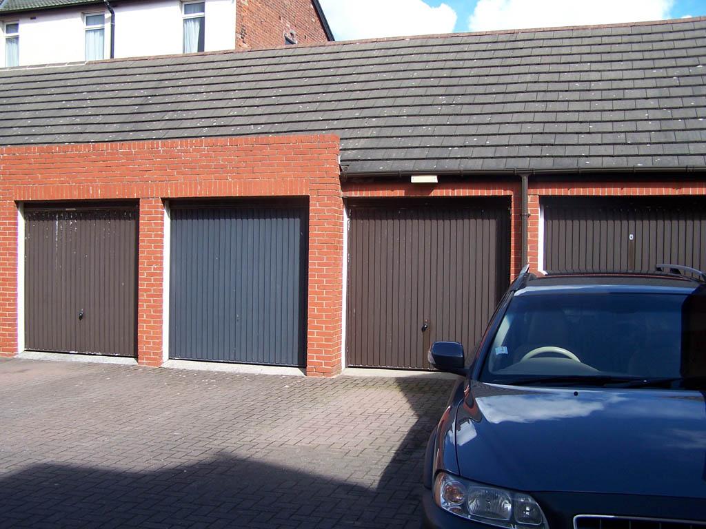 Garage doors before Revampz garage door refurbishment